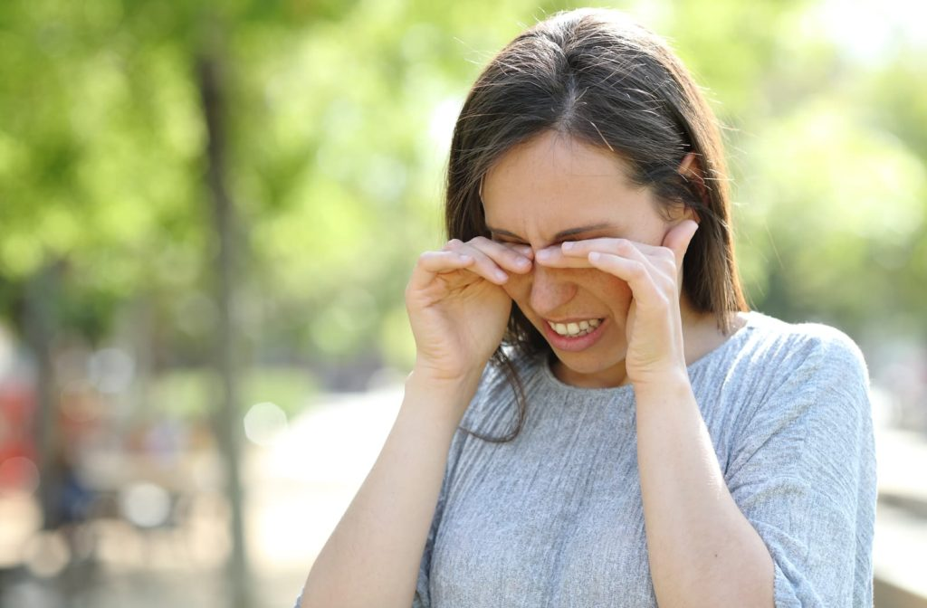Woman rubbing her eyes because of dry eye or allergies