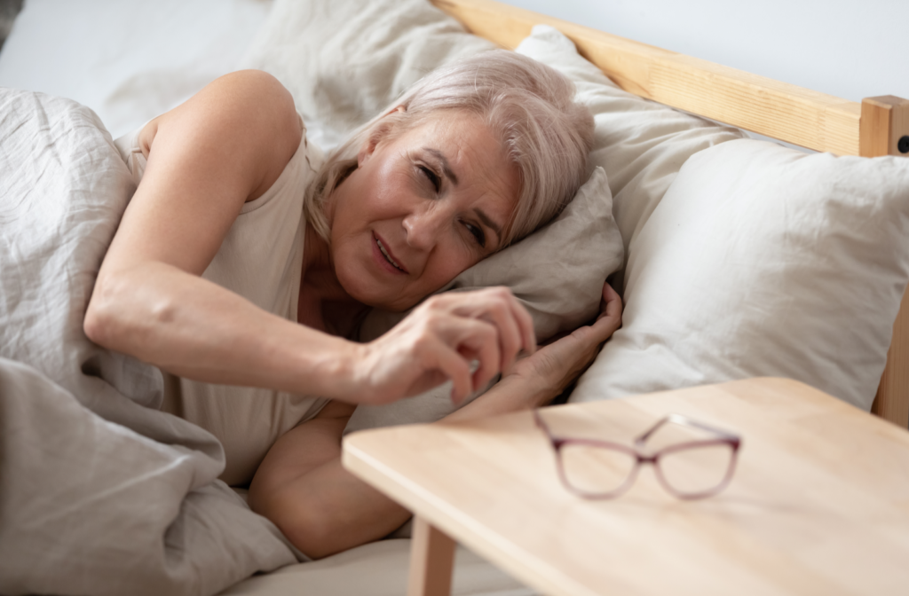 Mature woman waking up with swollen dry eyes